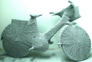 Clair Walton, Dying West (2009), bicycle and wool, 178 cm x 1000 cm x 550 cm